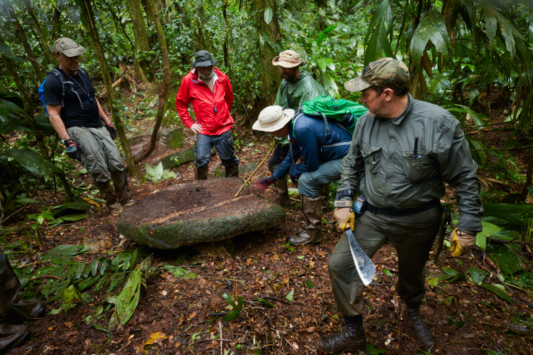 The scientific team examines what are believed to be construction stones lining the top of a plaza that once was used by an ancient civilization in the Mosquitia jungle.