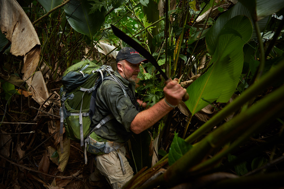 Jungle guide and former British SAS solder Andrew Wood hacks a path through the Mosquitia jungle for the team of scientists.
