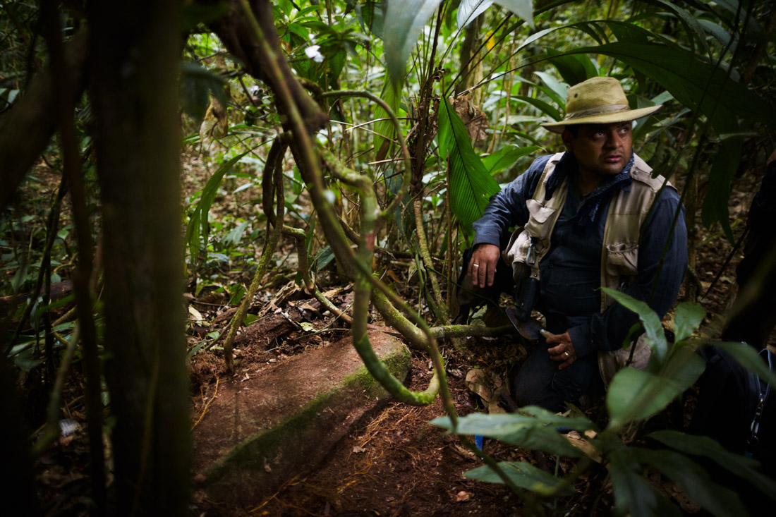 Honduran archeologist Oscar Neil Cruz examines a construction stone he discovered in a secret location in the Mosquitia jungle in Honduras that revealed evidence of an ancient culture that were once neighbors to the Maya.