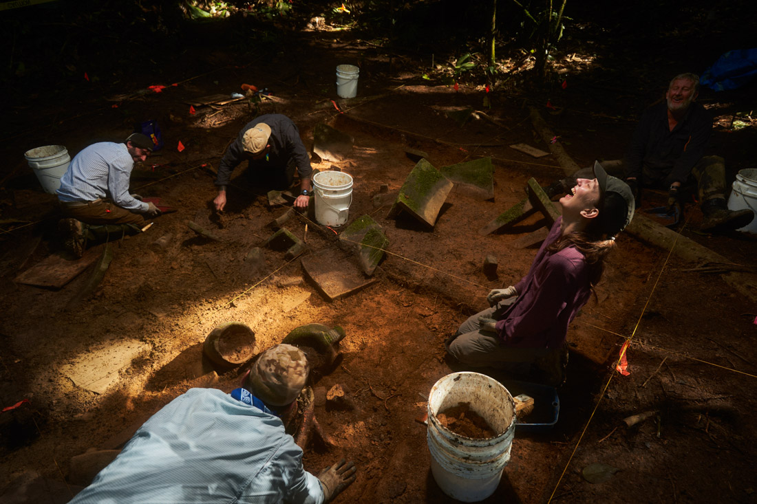 Archeologists dig in the cache site deep in the Mosquitia jungle of Honduras. They were uncovering a ceremonial site containing numerous stone carvings and vessels.