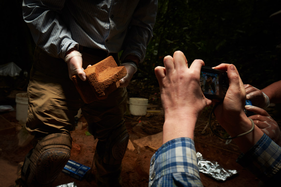 Archeologists remove artifacts from the cache site in the Mosquitia jungle in Honduras.