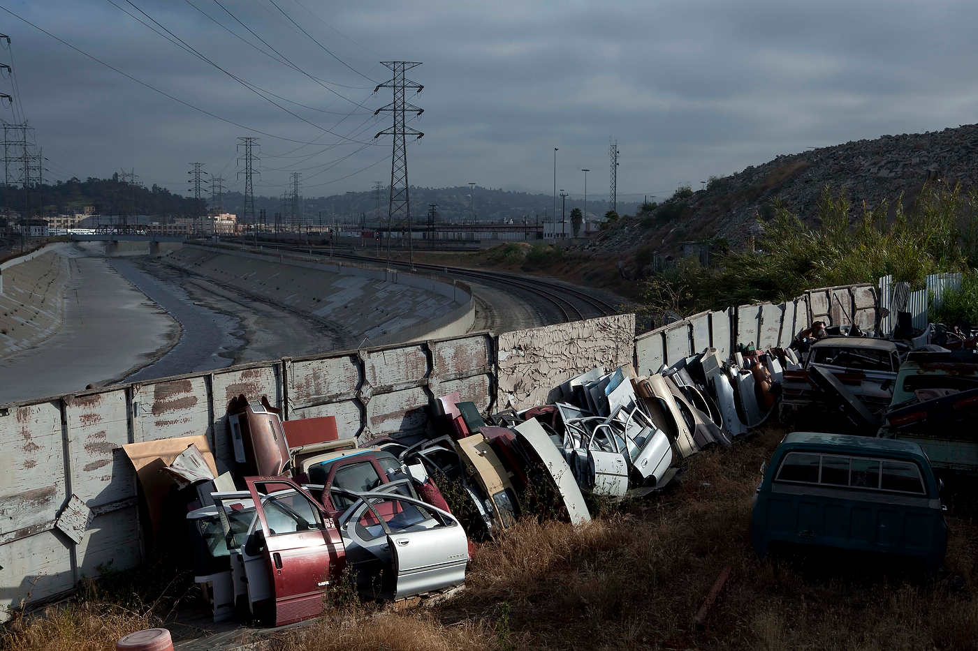 Junk yard near the Los Angeles River, Line 68.