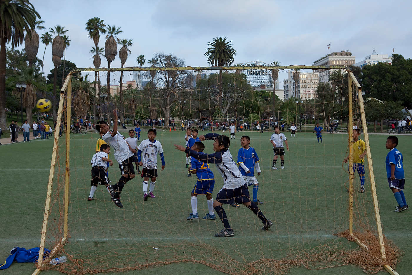 Soccer game in Mac Arthur Park, a Latino immigrant neighborhood, Line 720.