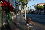 Homeless, early morning on Hollywood Boulevard, Line 302.