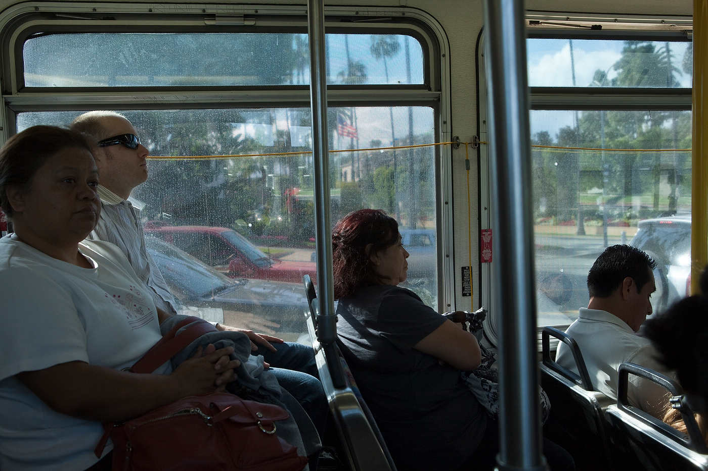 Passengers ride through Beverly Hills on Sunset Boulevard, Line 302.