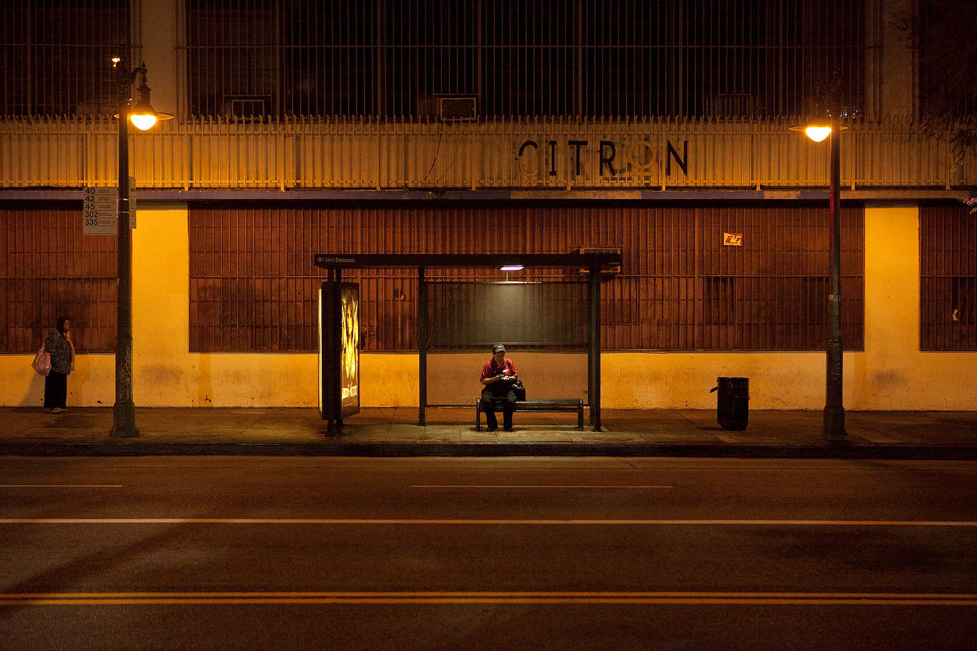 Night shift worker, Line 4 bus stop (open 24h), downtown Los Angeles.