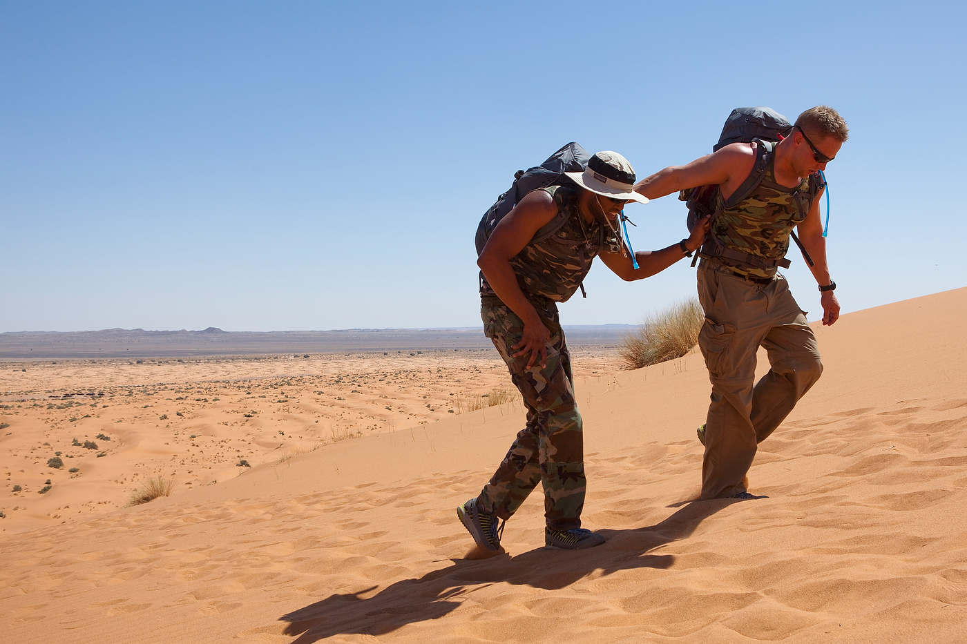 Team Country Boys struggles in stage one's heat in the Merzouga Dunes, Sahara Desert.