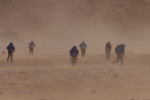 Teams get caught in a sand storm shortly after leaving an overnight camp.