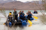 Team Grandpa's Warriors leads Kansas and California Girls on homemade boats