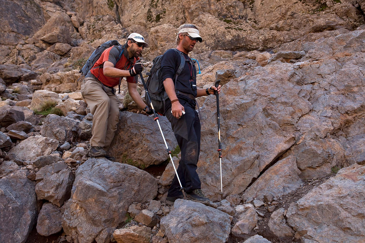Team No Limits' Eric Weihenmayer, who is blind, follows teamate Jeff Evans as they decend from the High Atlas Mountains.
