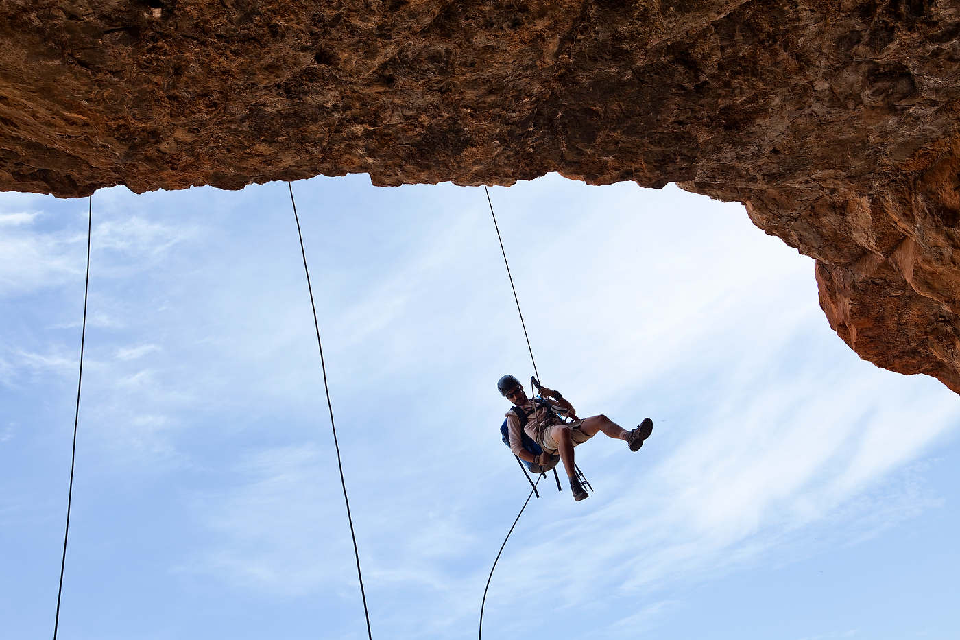 Team Gypsies John Post rappels into a cave.