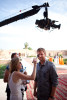 Host Dave Salmoni gets prepped at the finnish line in Marrakesh.