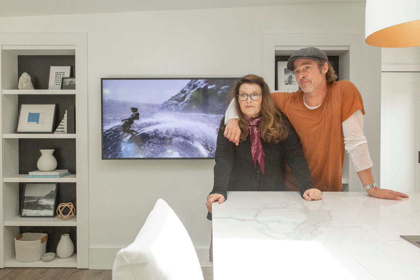 Brad Pitt and his make-up artist and friend for 27 years Jean Black after the reveal of Jean' newly renovated garage. With the help of Brad Pitt, hosts Drew Scott and Jonathan Scott have transformed Jean's garage into a modern guest suite, in Santa Monica, California, as seen on Celebrity I.O.U.