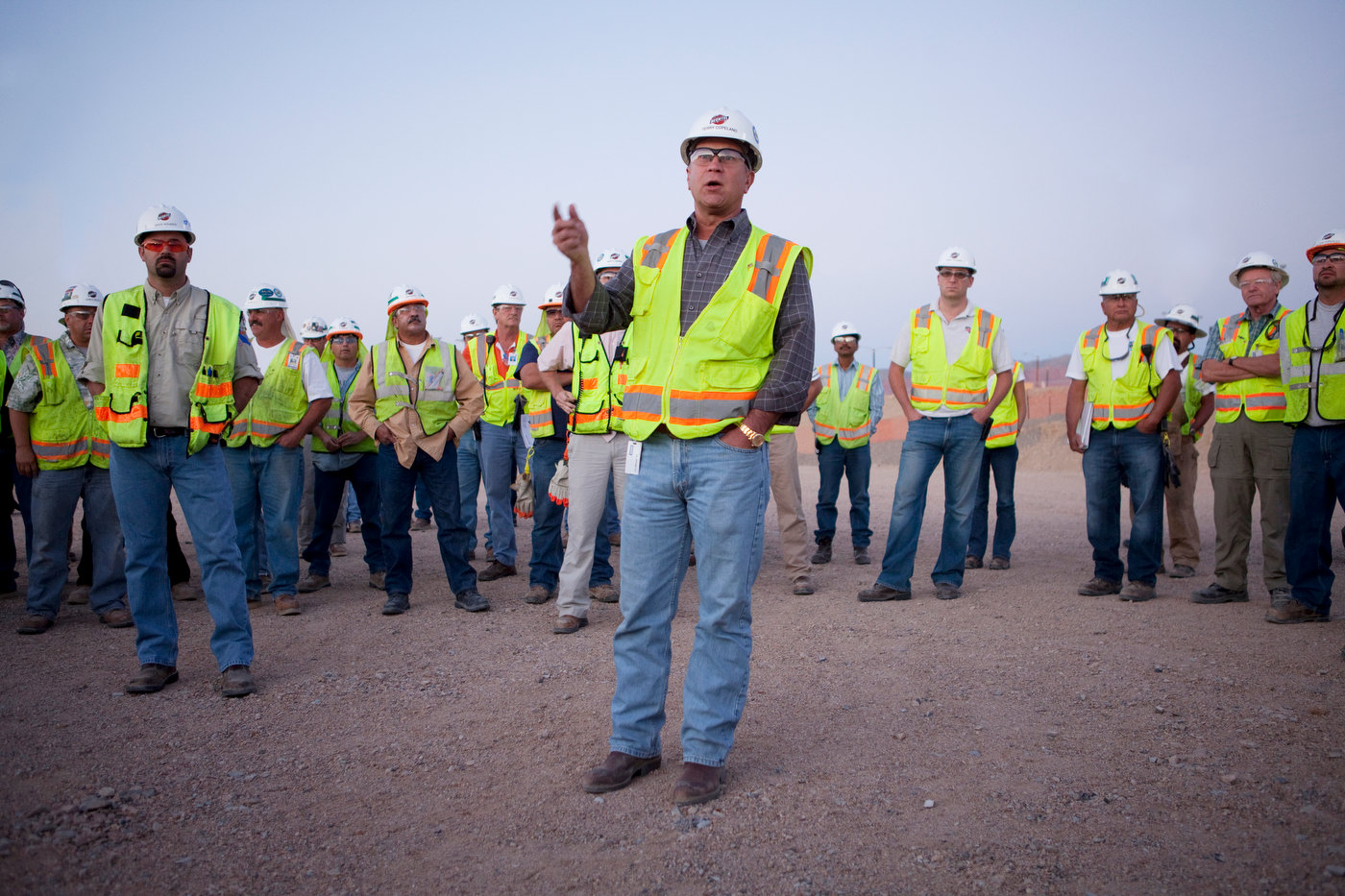 IVANPAH, CALIFORNIA, AUGUST 11 2011: Terry Copeland adresses workers during a daily safety meeting at 5:30 AM at the main area at the Ivanpah project site.