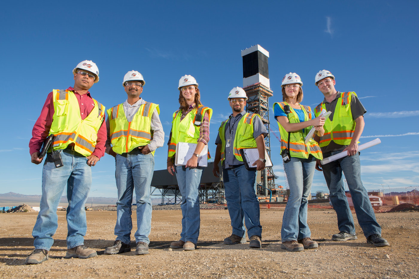 IVANPAH, CALIFORNIA, OCTOBER 18 2012: Left to Right, Ashok Sahu, Shriram Waghmode, Jennifer Arnold, Mike Fahim, Emma Klaus and Marc Coleman near Tower 1, at the Ivanpah Solar Project (photo Gilles Mingasson/Getty Images for Bechtel).