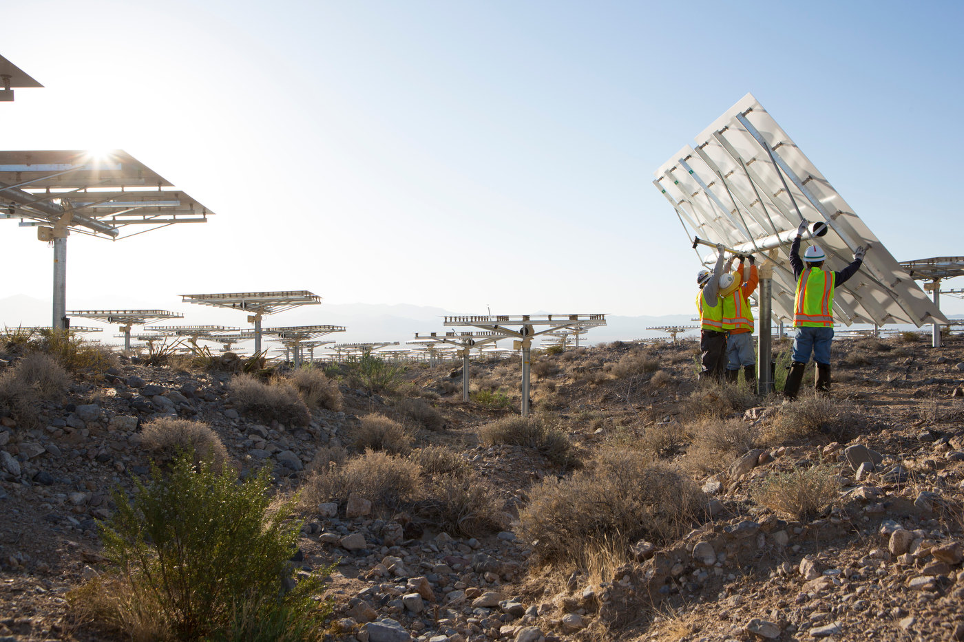IVANPAH; CALIFORNIA; MAY 2012: A crew flips a heliostat to its stowed position near Tower One at sunrise at the Ivanpah Solar Project (photo Gilles Mingasson/Getty Images for Bechtel).