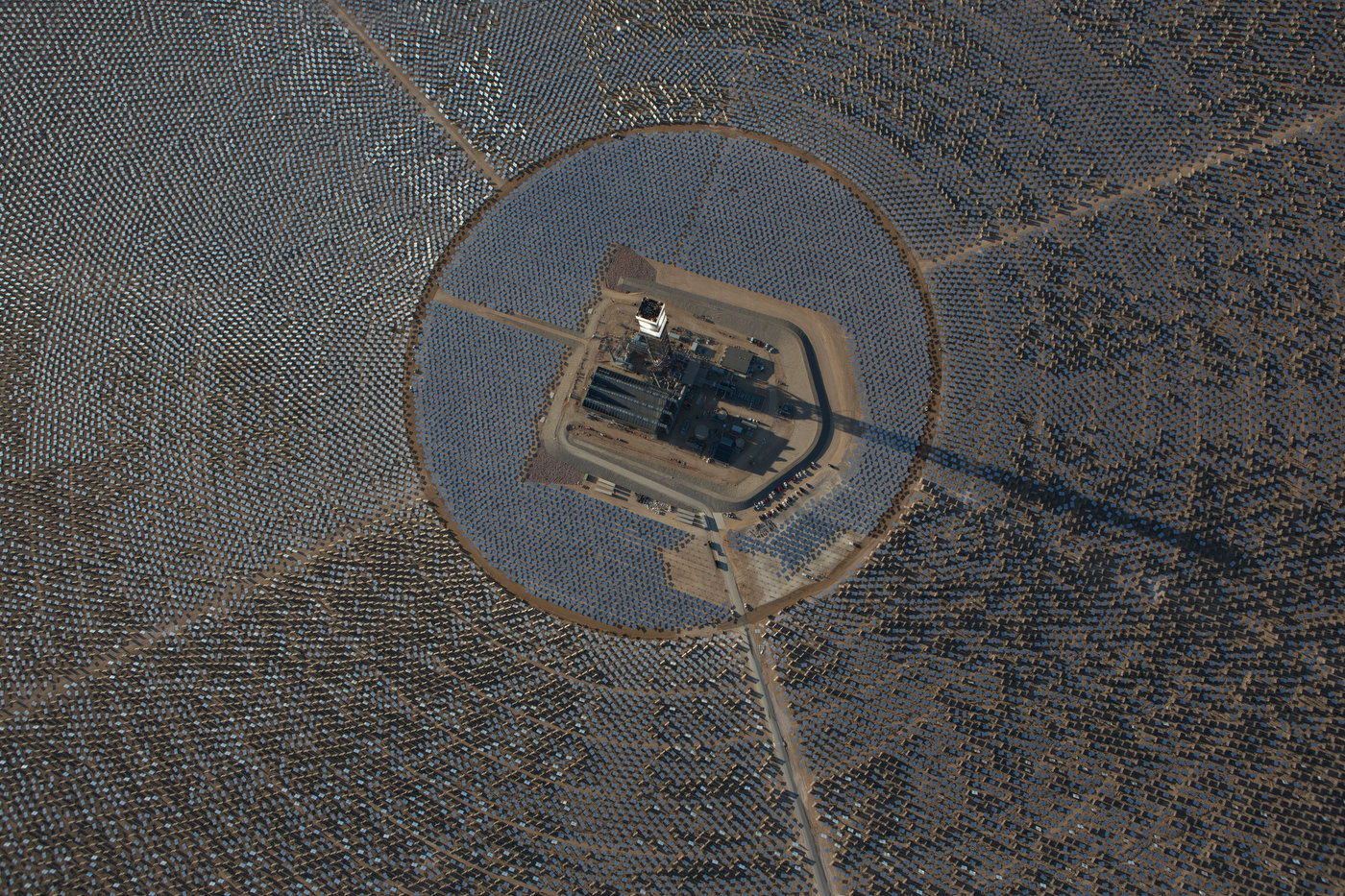 IVANPAH, CALIFORNIA, APRIL 05 2013: An aerial view of Tower 1 and its heliostats at  the Ivanpah Solar Power Facility. The top of Tower 1's is {quote}lit{quote} as steam blow tests are in progress. Located in the Mojave Desert 40 miles southwest of Las Vegas, The Ivanpah Solar Power Facility is a solar thermal power project, currently under construction, with a planned capacity of 392 megawatts, enough to power approximately 140,000 houses. It will deploy 170,000 heliostat mirrors spread over 4,000 hectares, focusing solar energy on boilers located atop three solar power towers, generating steam to drive specially adapted steam turbines The project, developed by Bechtel, will cost $2.2 billion and be the largest solar farm in the world (photo Gilles Mingasson/Getty Images for Bechtel).