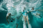 LOS ANGELES, CALIFORNIA, USA - SEPTEMBER 02 2012: Four friends jump in a swimming pool to escape the late summer heat in Los Angeles (photo Gilles Mingasson).