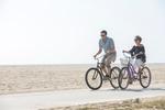 Host Drew Scott and fiancee Linda Phan enjoy a bike ride on the Venice Beach boardwalk, as seen on Property Brothers at Home: Drew's Honeymoon House.