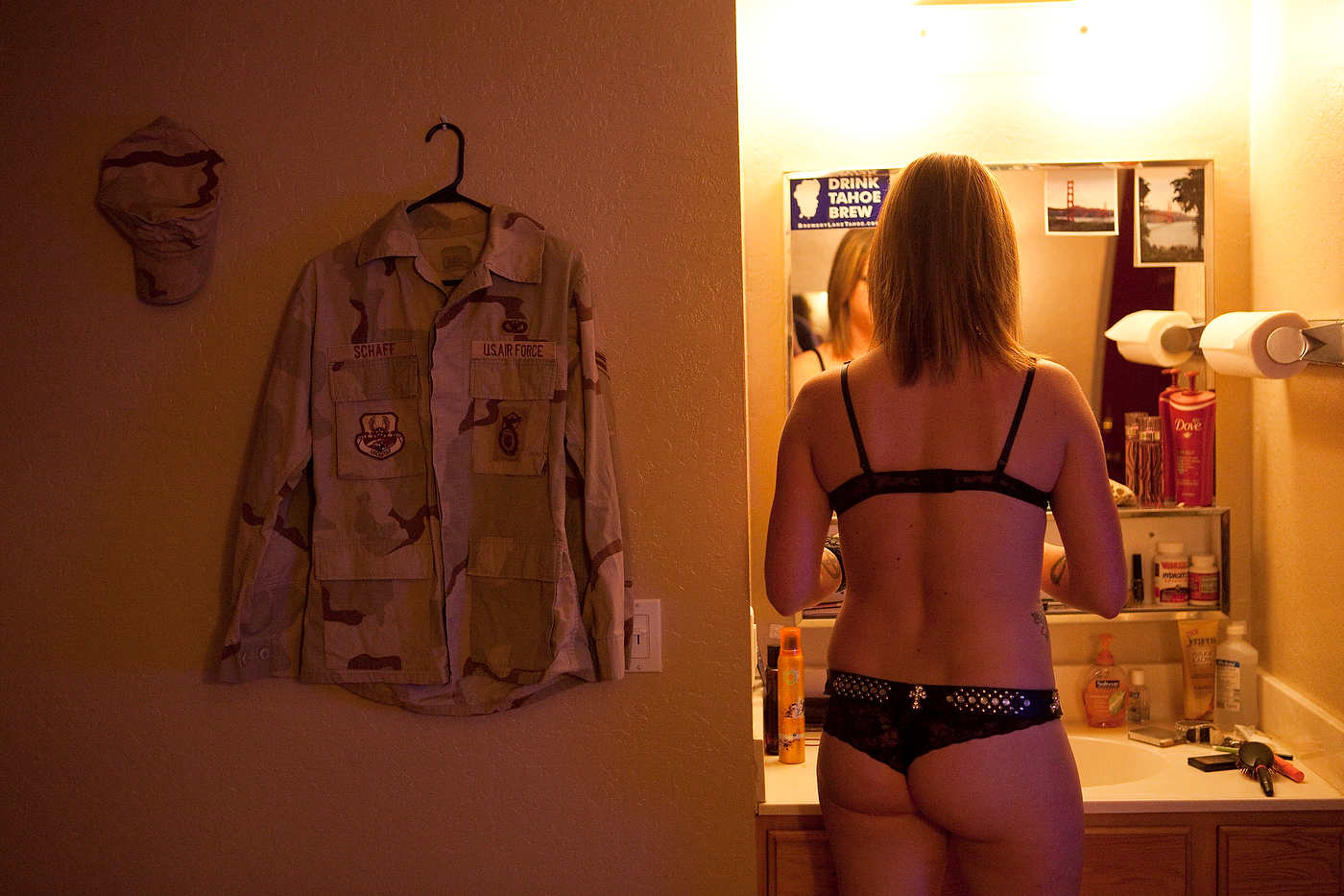 Iraq veteran Air Force Amber gets ready for a client.