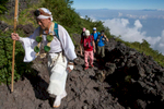 A traditionally dressed hiker on the Yoshida trail, Mount Fuji's most popular route.