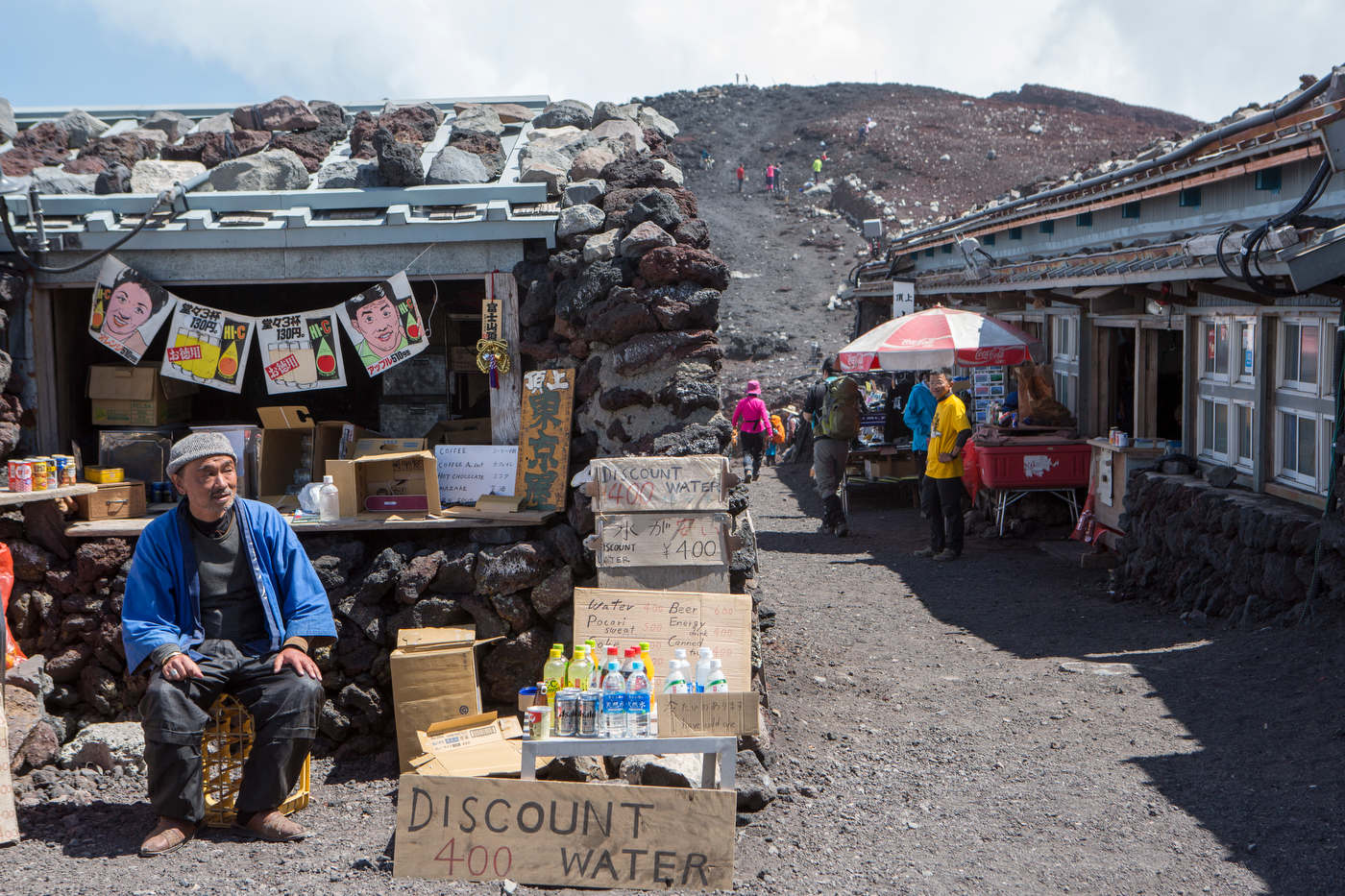 Souvenir stores greets hikers on Mount Fuji's 13,389 ft summit.