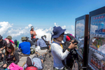 A hiker buys a cold drink from a vending machine on Mount Fuji's 13,389 ft summit.