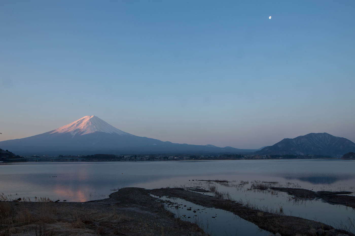 Mt. Fuji reflects in the waters of Lake Kawaguchiko at sunrise.