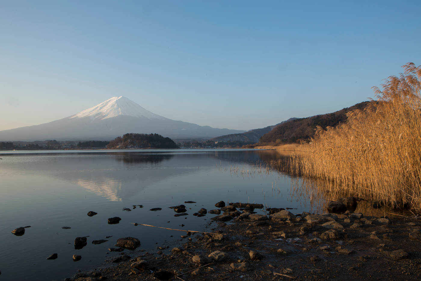 Mt. Fuji reflects in the waters of Lake Kawaguchiko.