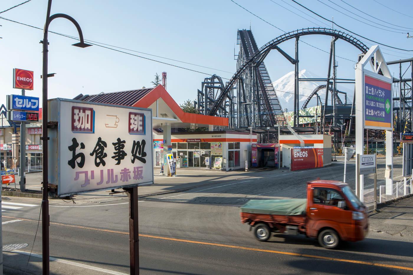 Mt. Fuji, framed by an amusement park roller coaster.