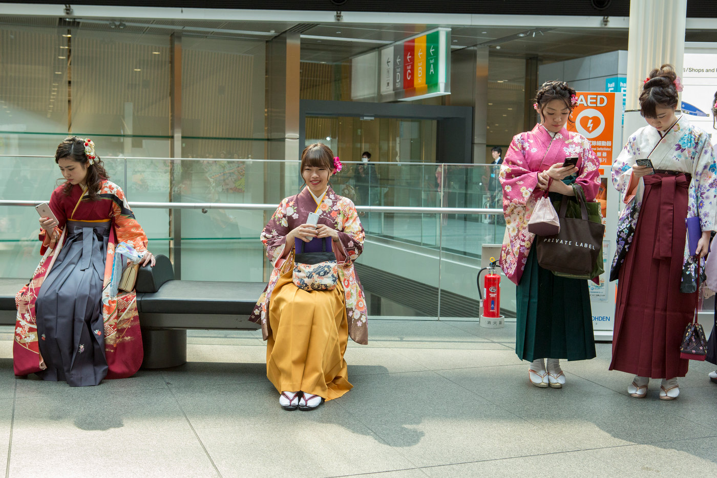 Girls dressed in tradittional kimono for a graduation ceremony.