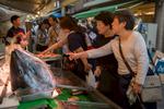 A tuna head greets visitors at a fish stand in the Tsukiji exterior fish market.