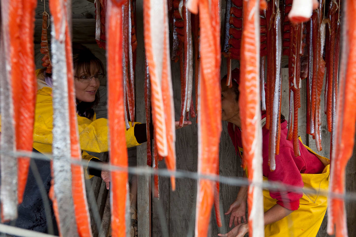 Sarah Palin's cousin Ina Bouker shows how salmon is smoked in Ekok, an Eskimo summer fishing village.