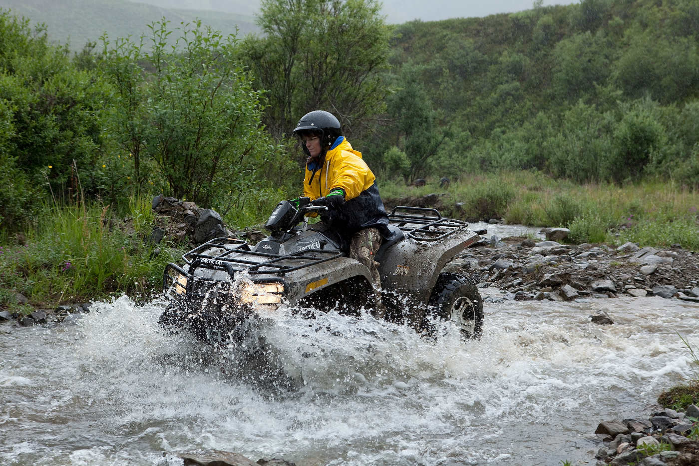 Sarah Palin rides an ATV near Bellanger Pass.