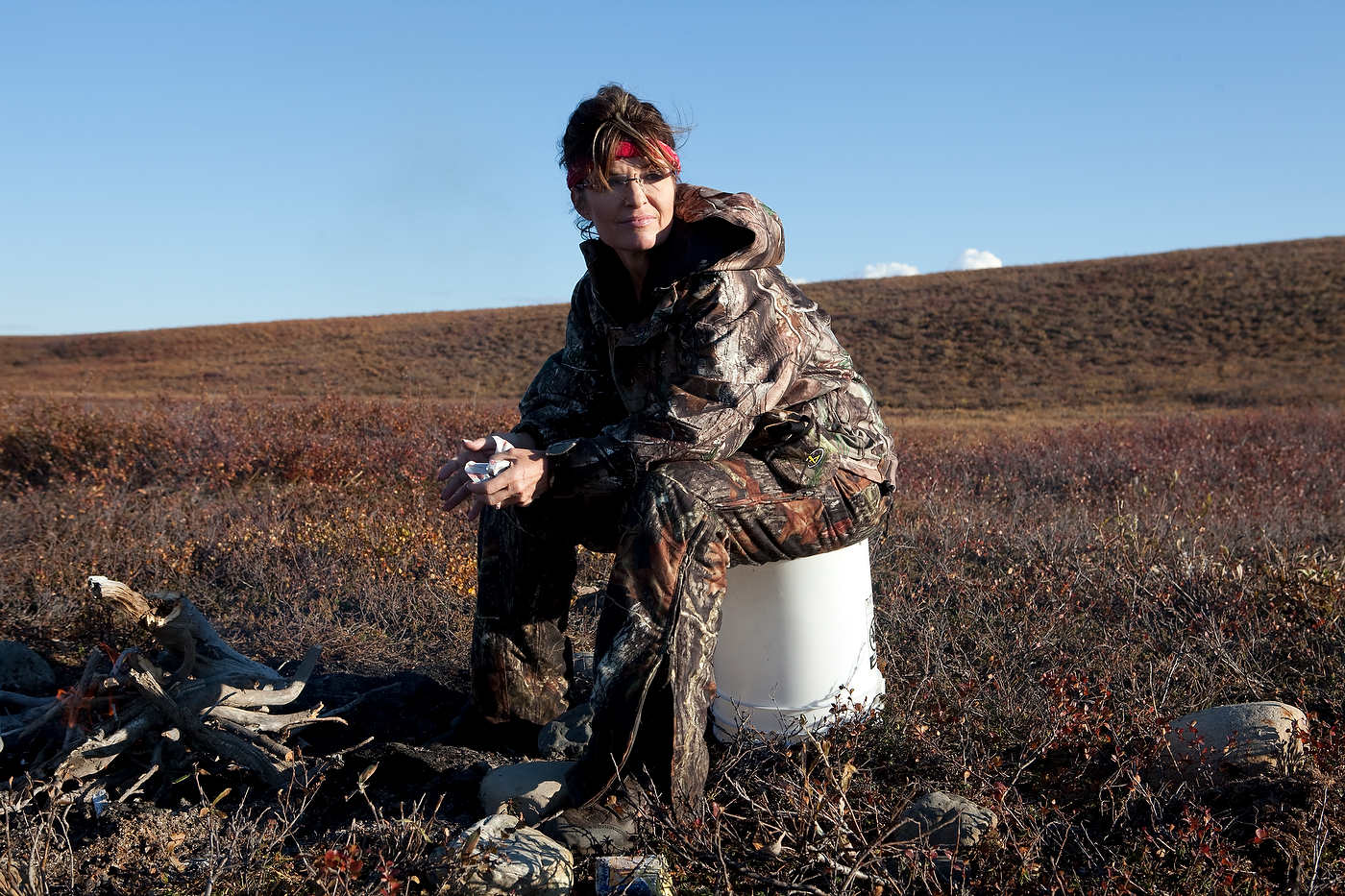 After an unfruitfull day of caribou hunting, Sarah Palin rests near Kavik, north of the Arctic Circle.