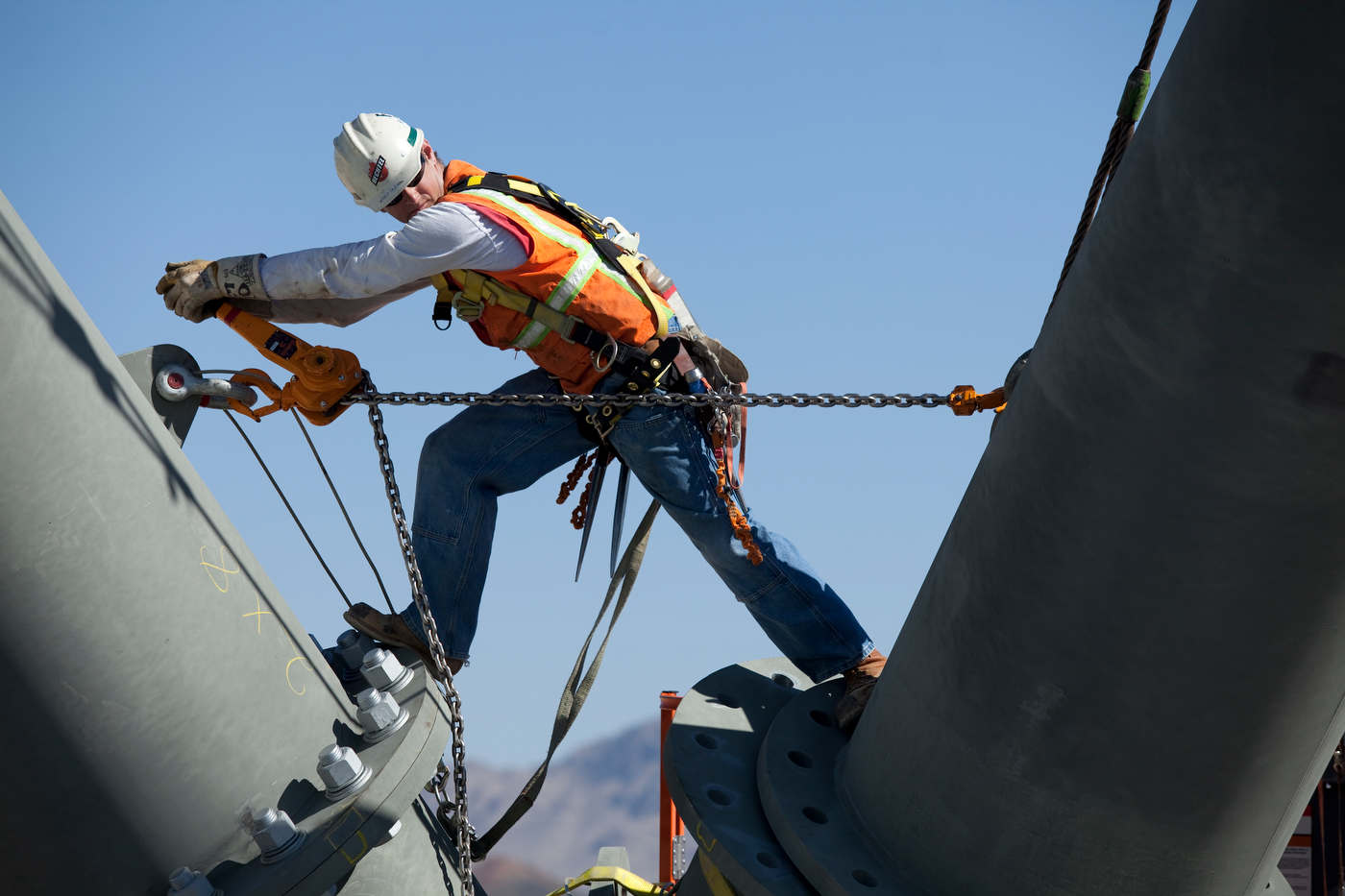 An Iron workers secures a large steel A frame on top of Tower 1.