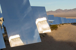 Tower 1 reflects in two of Ivanpah's 174,000 mirrors.