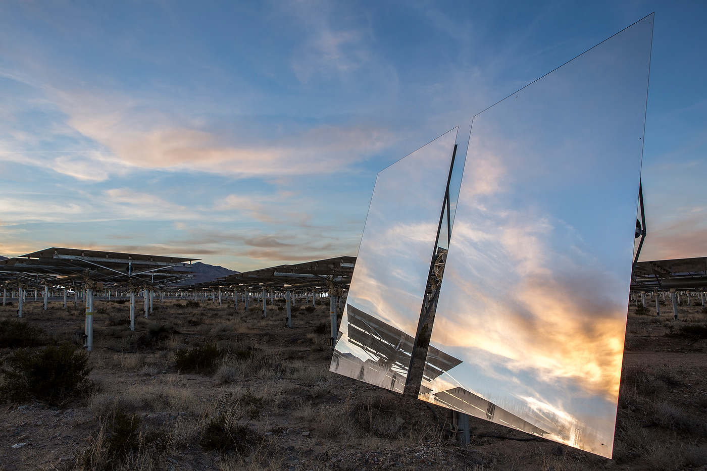 The setting sun reflects in one of Ivanpah's 174,000 mirrors.