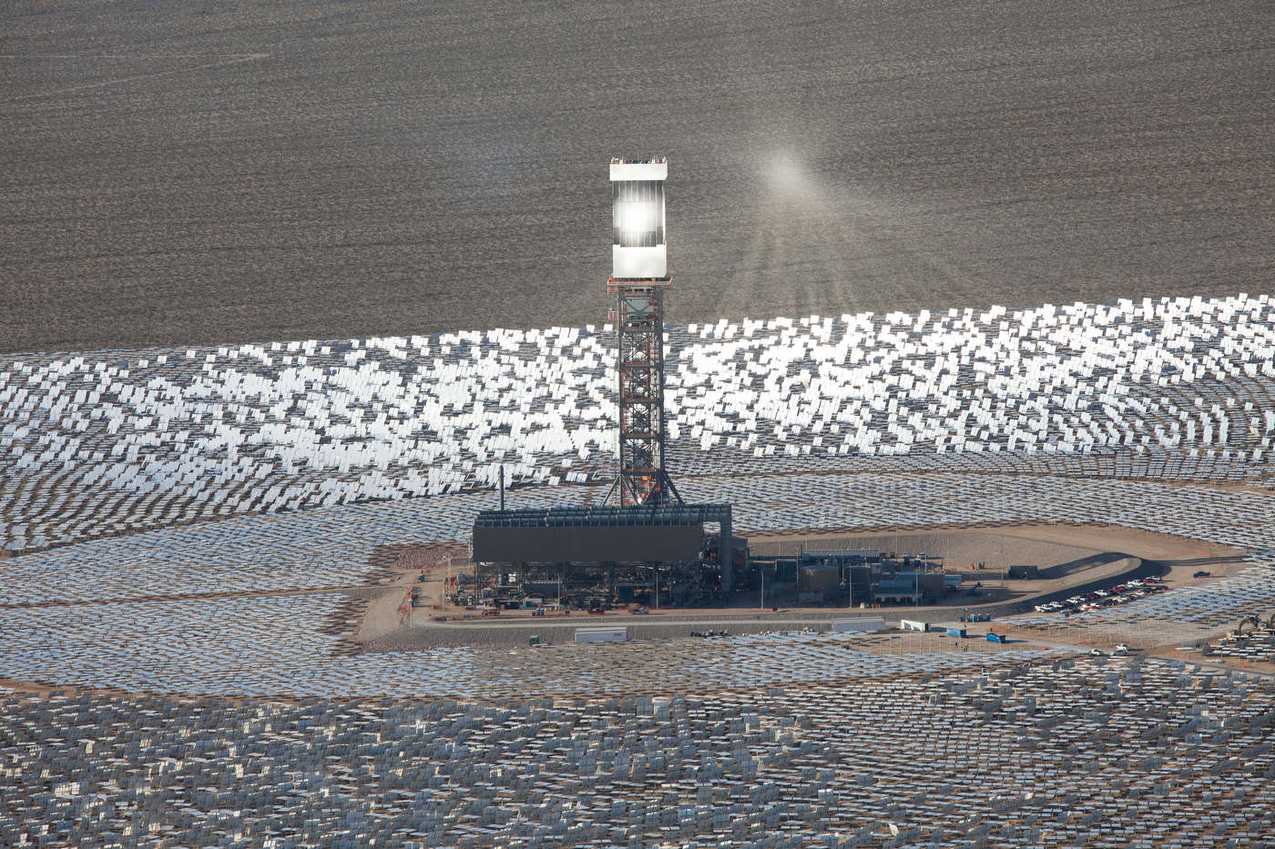 Sunlight reflected by some of the farm's 174,000 mirrors hangs near the top of Tower 3 during a test.