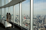 ROPPONGI HILLS, TOKYO, JAPAN - JANUARY 31 2017: Visitors take in the view from the observation deck of the Roppongi Hills Mori Tower, a 54-story mixed-use skyscraper located in Roppongi. Completed in 2003, the Mori Tower is the centerpiece of the Roppongi Hills urban development. It is currently the sixth-tallest building in Tokyo at 238 meters (781 ft). The tower has a floor space area of 379,408m squared (4,083,910 sq ft), making it one of the largest buildings in the world by this measure. The Mori Tower building is primarily used for office space (several of the world's largest corporations have their headquarters there), but it also includes retail stores, restaurants and the Mori Art Museum on the 53rd floor (photo Gilles Mingasson for National Geographic Books).