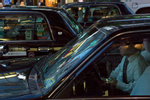 CENTRAL TOKYO -MAY 2017: Taxi driver in the evening traffic (photo Gilles Mingasson).
