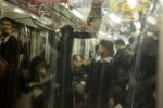 TOKYO: A school boy rides the subway home (photo Gilles Mingasson).