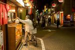 TOKYO -MAY 2017: Bicycle take out on a neighborhood pedestrian street in Shinjuku-ku. Many Japanese use their bicycle to shop after work for their evening meal (photo Gilles Mingasson).