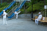 SINJUKU-KU, TOKYO -MAY 2017: Locals exercise with an early morning session of rajio taisō in Edogawa park. Rajio taisō was introduced to Japan in 1928 as a commemoration of the coronation of Emperor Hirohito. The idea for radio broadcast calisthenics came from the US, where during the 1920s the Metropolitan Life Insurance Co. sponsored 15-minute radio calisthenics in major cities in the US. Visiting employees of the Japanese postal insurance division brought samples of the exercises from the US back to Japan. The exercises were widely used to improve the health of Japanese soldiers both at home and abroad during the 1930s and 1940s. After Japan's defeat in 1945, the broadcasts were banned by the occupying powers as being too militaristic in nature. After several rewrites to the exercise routine, it was reintroduced by NHK radio in 1951 with the support of the education ministry, health ministry, the Japan Gymnastic Association and the Japan Recreation Association (photo Gilles Mingasson).