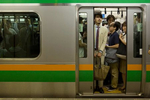 TOKYO -MAY 2017: Tight fit for commuters at rush hour on the Tokyo Subway (photo Gilles Mingasson).