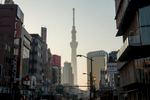 ASAKUSA, TOKYO, JAPAN - MAY2017: A view of the Sky Tree from Asakusa. Towering over the Sumida neighborhood in north east Tokyo, Tokyo's Sky Tree offers unparalleled views of the city. Completed in 2012, is the world's tallest tower at 634.0 metres, or 2,080 ft. The base of the tower has a structure similar to a tripod; from a height of about 350 m (1,150 ft) and above, the tower's structure is cylindrical to offer panoramic views of the river and the city. There are observatories at 350 m (1,150 ft), with a capacity of up to 2000 people, and 450 m (1,480 ft), with a capacity of 900 people.The upper observatory features a spiral, glass-covered skywalk in which visitors ascend the last 5 meters to the highest point at the upper platform. A section of glass flooring gives visitors a direct downward view of the streets below. The tower has seismic proofing, including a central shaft made of reinforced concrete. The main internal pillar is attached to the outer tower structure for the first 125 meters (410 ft) above ground. From there until 375 meters (1,230 ft) the pillar is attached to the tower frame with oil dampers, which act as cushions during an earthquake. Additional resilience is achieved through an {quote}added mass control mechanism{quote} (or tuned mass damper) - a damping system which, in the event of an earthquake, moves out of step with the building's structure, to keep the center of gravity as central as possible to the tower's base. According to the designers, the dampers can absorb 50 percent of the energy from an earthquake (photo Gilles Mingasson for National Geographic Books).