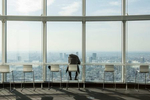 ROPPONGI HILLS, TOKYO, JAPAN - JANUARY 31 2017: A visitor finds peace and quiet and unobstructed views on the observation deck of the Roppongi Hills Mori Tower, a 54-story mixed-use skyscraper located in Roppongi. Completed in 2003, the Mori Tower is the centerpiece of the Roppongi Hills urban development. It is currently the sixth-tallest building in Tokyo at 238 meters (781 ft). The tower has a floor space area of 379,408m squared (4,083,910 sq ft), making it one of the largest buildings in the world by this measure. The Mori Tower building is primarily used for office space (several of the world's largest corporations have their headquarters there), but it also includes retail stores, restaurants and the Mori Art Museum on the 53rd floor (photo Gilles Mingasson for National Geographic Books).