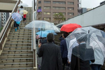 CENTRAL TOKYO -MAY 2017: Salarymen keep dry during a with a clear umbrealla, commonly used in Japan and for sale in most convenience stores (photo Gilles Mingasson).