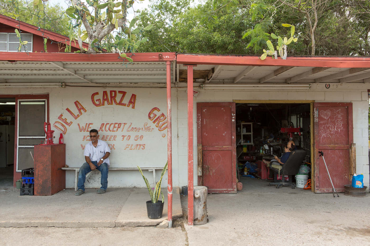 Martin De Lagarza's grocery and tire shop seats right across the wall separatig the U.S. and Mexico.