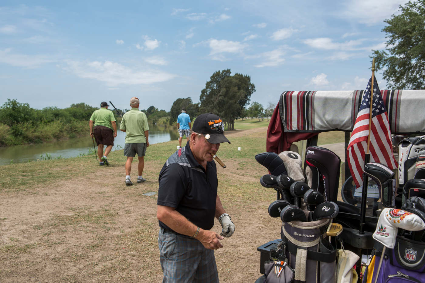 Golfers gear up for a round at the Riverbend Resort and Golf Club near the Rio Grande. The proposed wall extension would cut the golf resort in half.